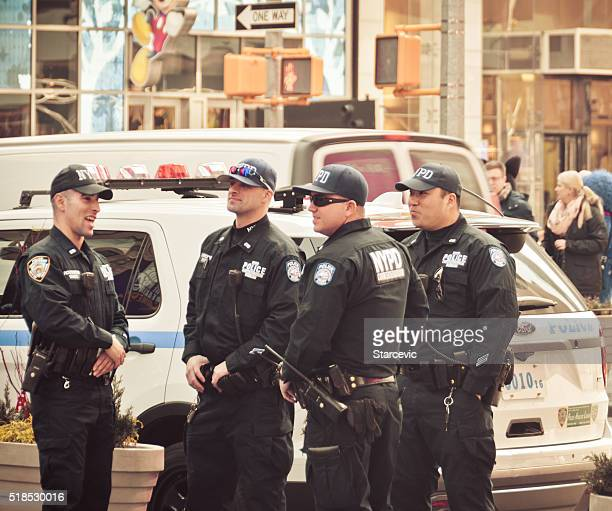 police officers on patrol in new york city - new york city police department stock pictures, royalty-free photos & images