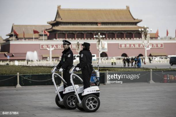 Police officers on Segways patrol Tiananmen Square in Beijing China on Sunday March 5 2017 China set a 2017 growth target of 'around 65 percent or...