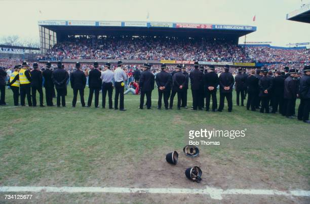 Police officers on the pitch at Hillsborough football stadium in Sheffield, after a human crush at an FA Cup semi-final game between Liverpool and...
