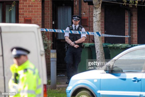 Police officers on the scene during a search on an address in Stanwell on September 17 2017 in London England A second man has today been arrested in...