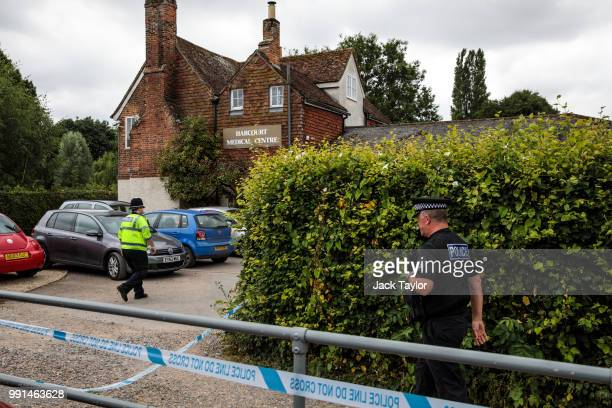 Police officers on the scene outside Harcourt Medical Centre by Queen Elizabeth Gardens in Salisbury thought to be connected to a man and woman in...