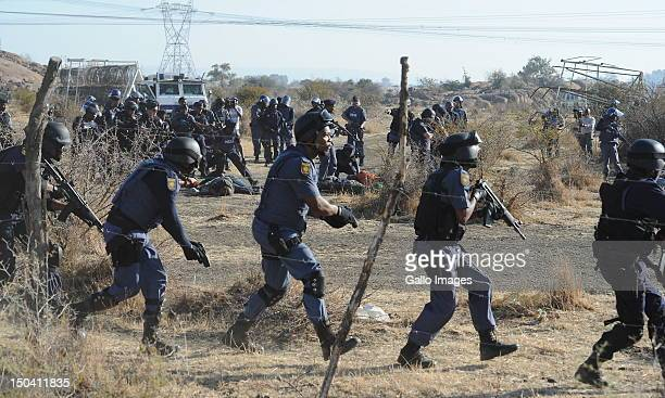 Police officers open fire on striking mine workers outside the Nkageng informal settlement on August 16 2012 in Marikana South Africa 30 people are...