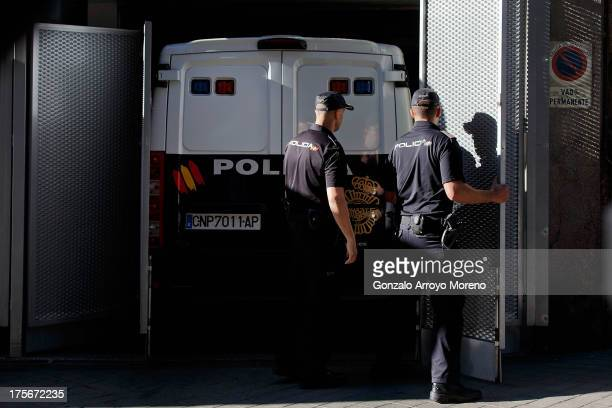 Police officers open security gates where the prison van transporting convicted paedophile Daniel Galvan Vina is parked at Audiencia Nacional court...