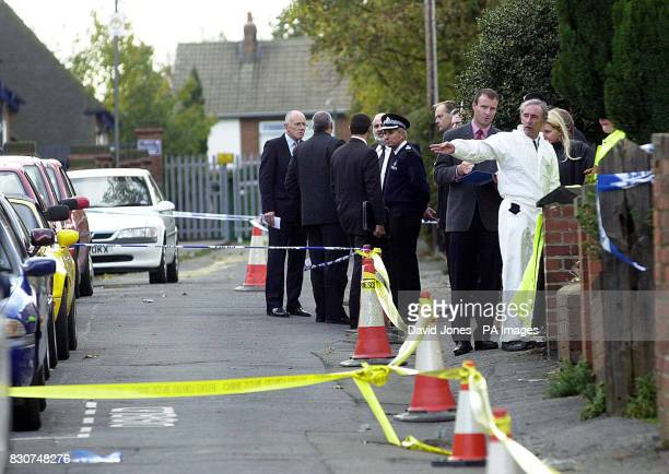Police officers outside the scene at Codnor in Derbyshire where a man was shot and killed by police marksmen following a domestic dispute The officer...