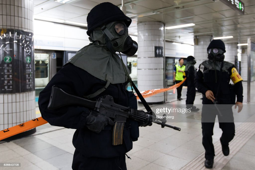 Police officers participate in an anti-terror drill on the sidelines of the Ulchi Freedom Guardian (UFG) military exercises at a subway station in Seoul, South Korea, on Tuesday, Aug. 22, 2017. North Korea warned the U.S. on Tuesday it will face 'merciless revenge' for ignoring Pyongyangs warnings over annual military drills with South Korea. Photographer: SeongJoon Cho/Bloomberg via Getty Images