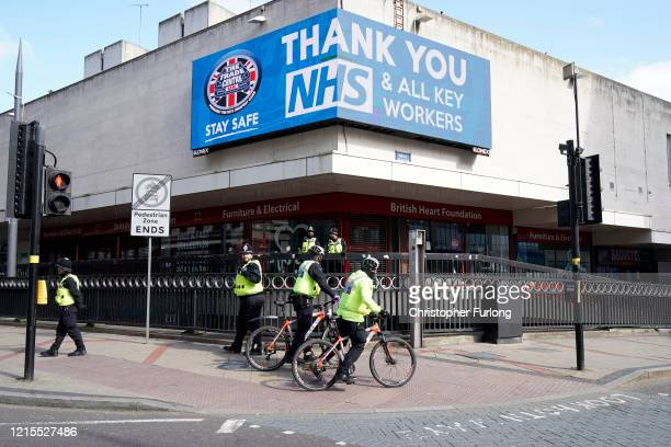 Police officers patrol a deserted Corporation Street in Birmingham city centre during the nationwide lockdown on March 29 2020 in Birmingham United...