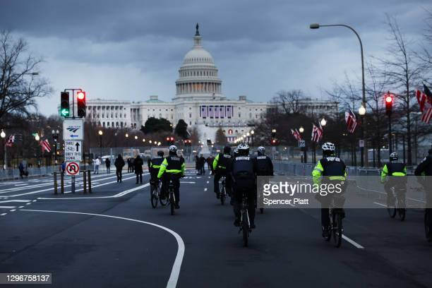 Police officers patrol a street leading to the U.S. Capitol on January 16, 2021 in Washington, DC. The National Guard is expected to deploy more than...