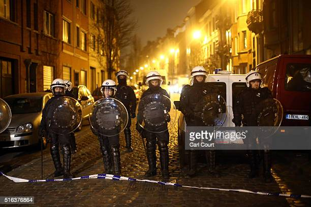 Police officers patrol after raids in which several people, including Paris attacks suspect Salah Abdeslam, were arrested on March 18, 2016 in...