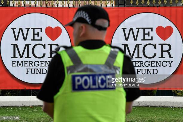 Police officers patrol around Old Trafford Cricket Ground ahead of the One Love Manchester tribute concert in Manchester on June 4 2017 Nearly two...