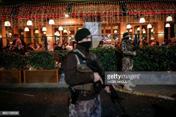 Police officers patrol around Taksim Square in Istanbul on December 31 2017 Turkey on December 30 arrested more suspected Islamic State group...