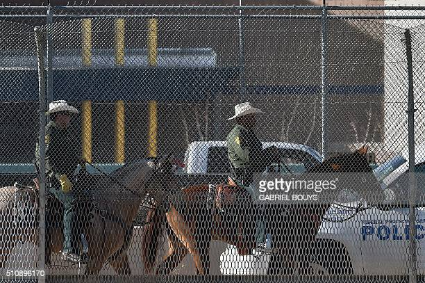 Police officers patrol as Pope Francis arrive at the MexicoUS border to celebrate mass at the Ciudad Juarez fairgrounds on February 17 2016 Throngs...