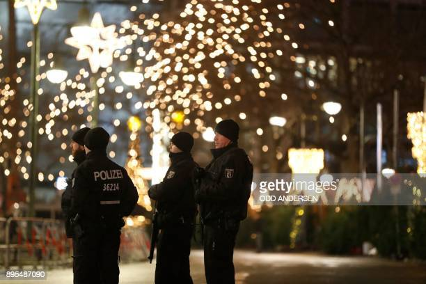 Police officers patrol at the Christmas market at Breitscheidplatz on the day of the anniversary of last year's deadly truck attack in Berlin in...
