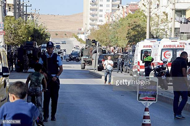 Police officers patrol at the explosion site on October 16 2016 near the Syrian border in Gaziantep after a bomber blew himself up A suspected...