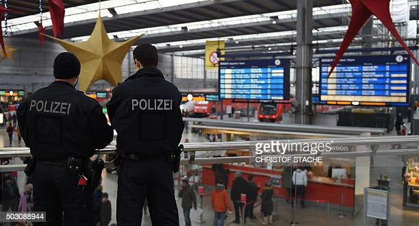 Police officers patrol at the main train station in Munich southern Germany on January 1 2016 German police lifted an alert of an imminent attack in...