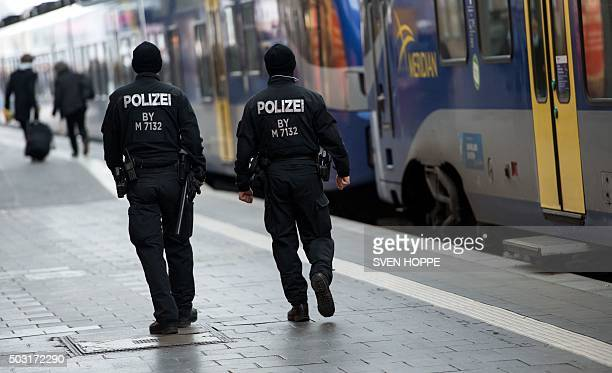 Police officers patrol at the main train station in Munich southern Germany on January 2 2016 German police on January 1 2016 lifted an alert of an...