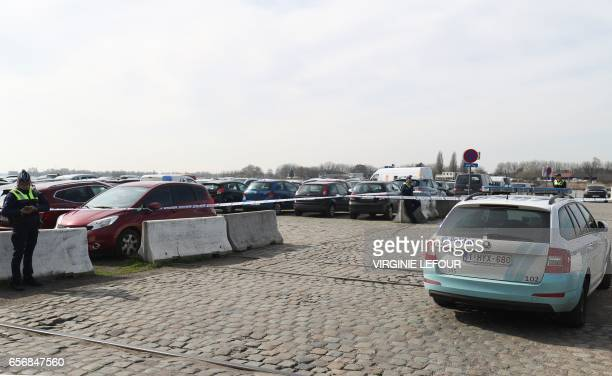 Police officers patrol at the SintMichielskaai in Antwerp where Belgian police arrested a man on March 23 2017 after he tried to drive into a crowd...