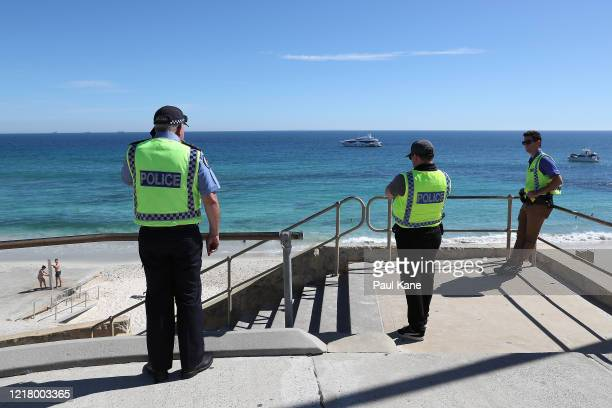 Police officers patrol Cottesloe Beach on April 10, 2020 in Perth, Australia. Australians have been urged to avoid all unnecessary travel over the...