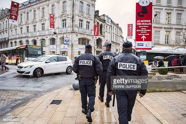 Police officers patrol in Angouleme where takes place the Angouleme International Comics Festival on January 29 2015 The world's leading comics...