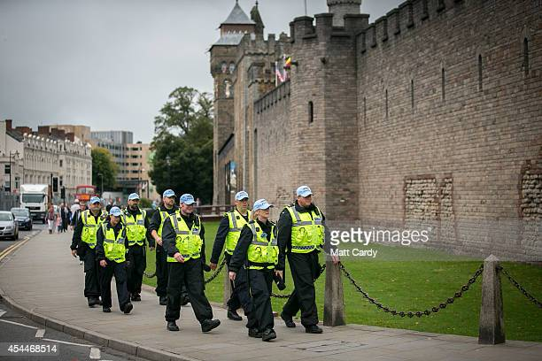 Police officers patrol in front of Cardiff Castle ahead of the Nato Summit 2014 that is being held in South Wales this week on September 1 2014 in...