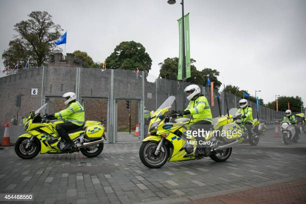 Police officers patrol in front of Cardiff Castle the Nato Summit 2014 that is being held in South Wales this week on September 1 2014 in Cardiff...