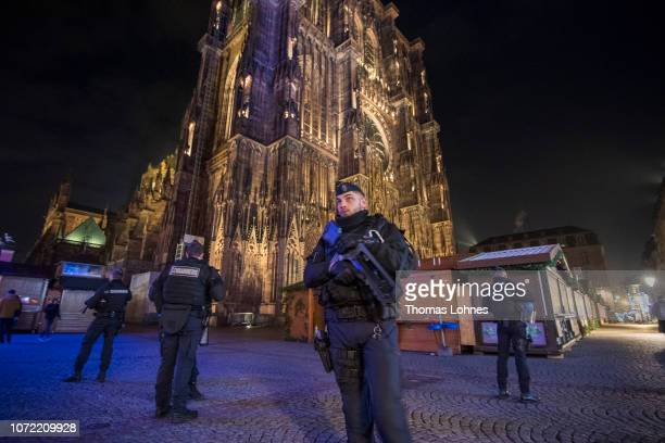 Police officers patrol in front of the cathedral near the Christmas market where the day before a man shot 14 people killing at least three on...