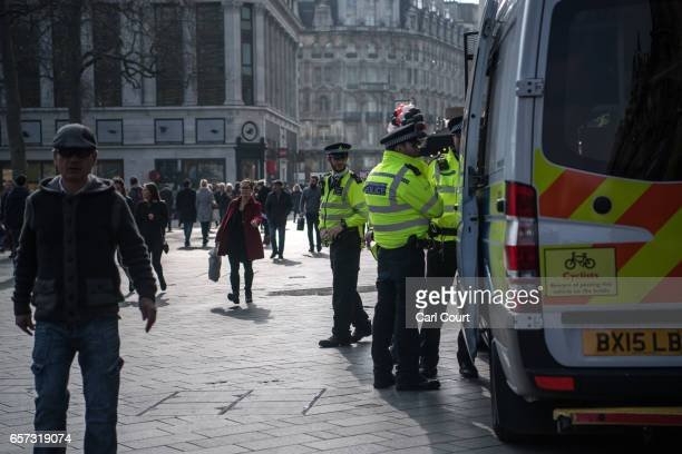 Police officers patrol in Leicester Square on March 24 2017 in London England A fourth person has died after Khalid Masood drove a car into...