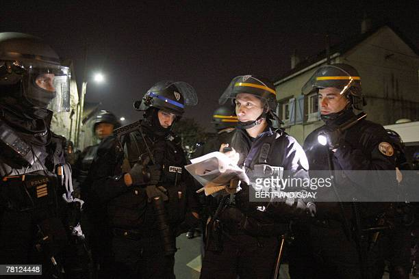 Police officers patrol in VilliersleBel outside Paris 27 November 2007 two days after the death of two teenagers in a crash with a police car Youths...