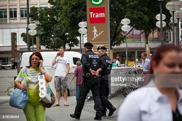 Police officers patrol near a tram station at Karlsplatz in Munich Germany on Saturday July 23 2016 German Chancellor Angela Merkel will convene an...