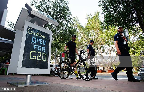Police officers patrol near the Brisbane Convention and Exhibition Centre on November 12 2014 in Brisbane Australia World economic leaders will...