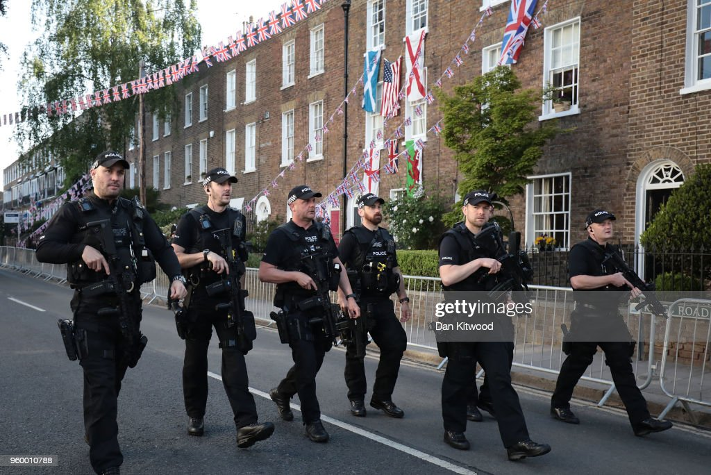 Police officers patrol near Windsor Castle prior to the wedding of HRH Prince Harry to Ms. Meghan Markle on May 19, 2018 in Windsor, England.