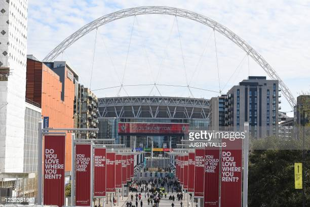 Police officers patrol Olympic Way outside Wembley Stadium ahead of the English FA Cup semi-final football match between Leicester City and...