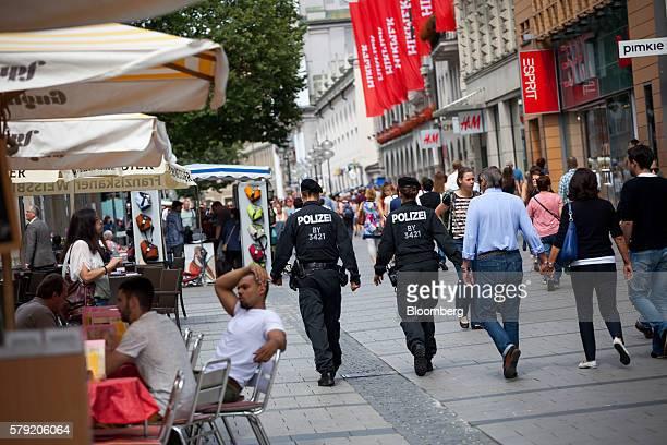 Police officers patrol on a shopping street in Marienplatz in Munich Germany on Saturday July 23 2016 German Chancellor Angela Merkel will convene an...