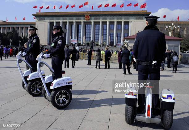 Police officers patrol on segways after the opening session of the National People's Congress at the Great Hall of the People on March 5 2017 in...