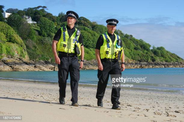 Police officers patrol on the beach in front of the Carbis Bay Hotel, host venue for the G7 Summit conferences, on June 03, 2021 in Carbis Bay,...