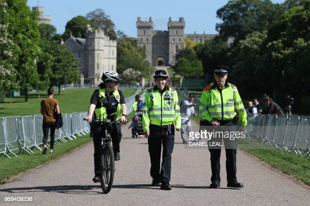 Police officers patrol on the Long Walk in Windsor on May 17 two days before the royal wedding of Prince Harry and Meghan Markle Britain's Prince...
