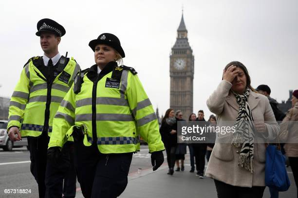 Police officers patrol on Westminster Bridge on March 24, 2017 in London, England. A fourth person has died after Khalid Masood drove a car into...
