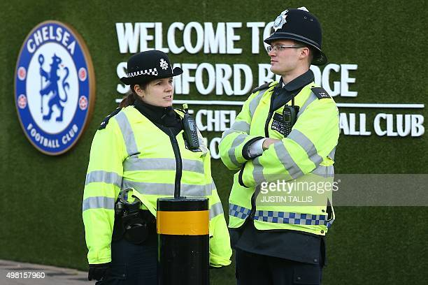 Police officers patrol outside Chelsea's Stamford Bridge Stadium before the start of the English Premier League football match between Chelsea and...