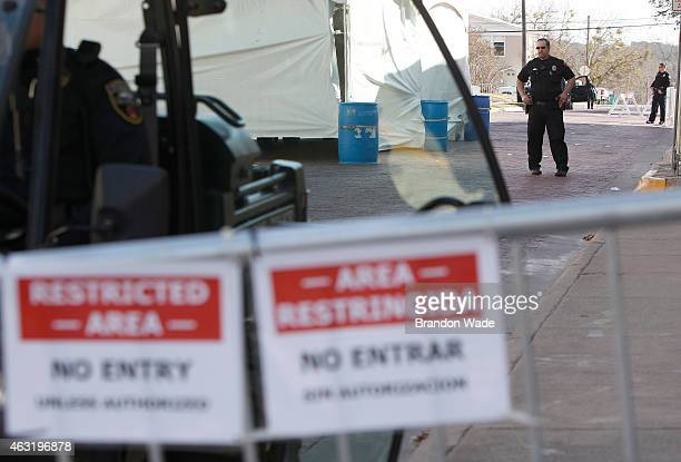 Police officers patrol outside of the Erath County Donald R Jones Justice Center on February 11 2015 in Stephenville Texas Security is tight for the...