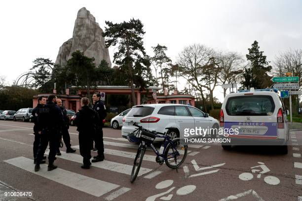 Police officers patrol outside of the Paris Zoological Park in the Bois de Vincennes eastern Paris on January 26 following the escape of nearly 50...