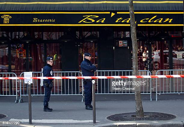 Police officers patrol outside the Bataclan concert hall where security forces are retracing the actions of the police during November's terrorist...