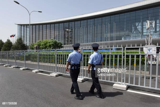 Police officers patrol outside the China National Convention Center the venue for the upcoming Belt and Road Forum for International Cooperation in...