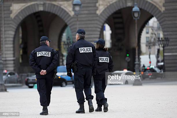Police officers patrol outside the Louvre museum during the United Nations COP21 climate summit in Paris France on Monday Nov 30 2015 French...