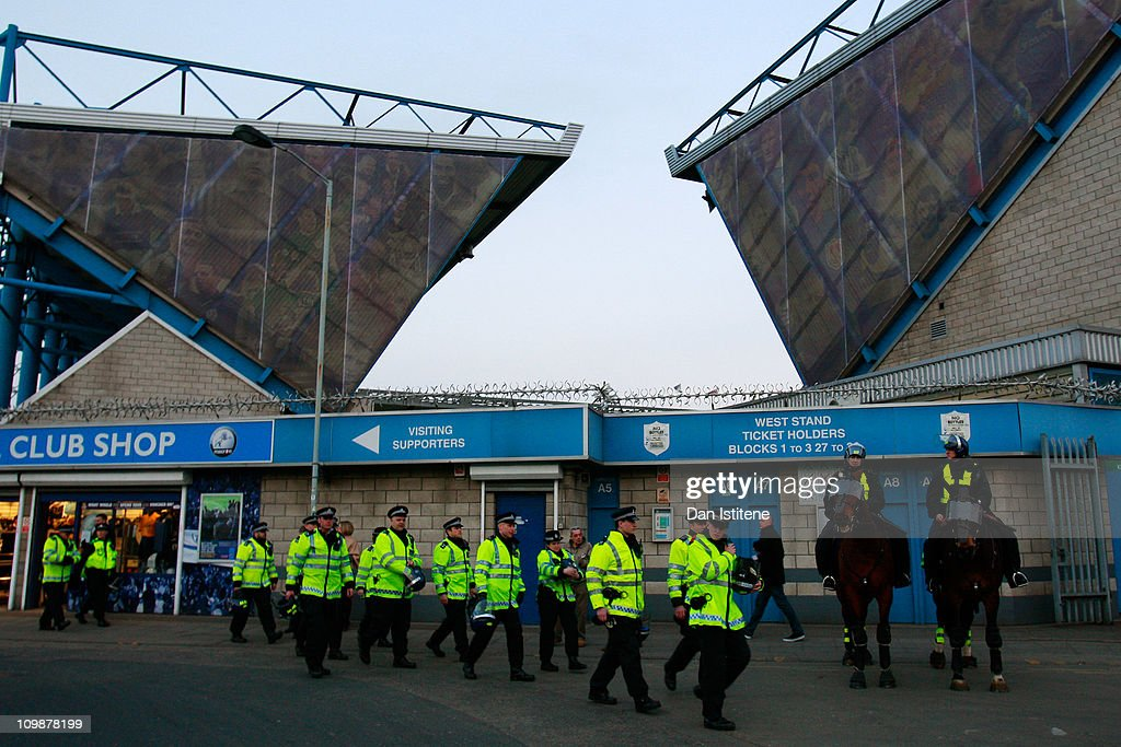 Police officers patrol outside the stadium before the npower    News