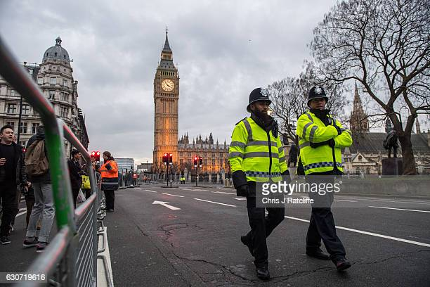 Police officers patrol Parliament Square after it is fenced off to the public in as security is steppedup across London ahead of New Year's...