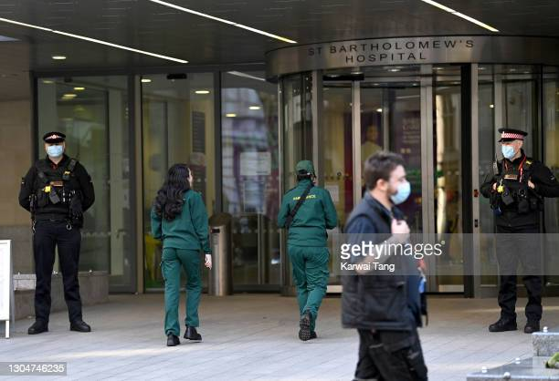 Police officers patrol St Bartholomew's Hospital where Prince Philip, Duke of Edinburgh is currently receiving treatment on March 01, 2021 in London,...