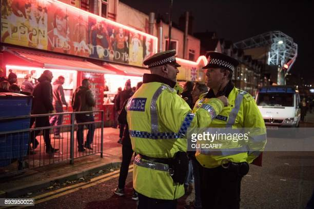 Police officers patrol the area around Old Trafford stadium prior to the UEFA Champions League group A match between Manchester United and CSKA...
