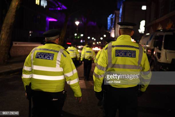 Police officers patrol the area as thousands gather to ring in later tonight the New Year on December 31 2017 in London England Crowds are starting...