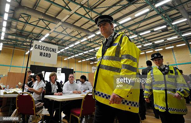 Police officers patrol the area where ballots will be counted where British National Party Leader and candidate for Barking Nick Griffin is standing...