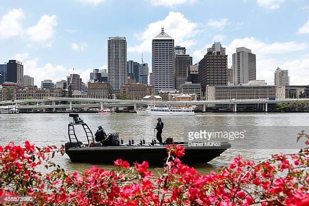 Police officers patrol the Brisbane river on November 13 2014 in Brisbane Australia World economic leaders will travel to Brisbane for the G20...