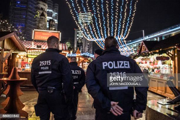 Police officers patrol the Christmas market at Breitscheidplatz in western Berlin's main shopping district ahead of the Christmas holidays on...